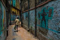 balanced builder (mailmesanu20111) Tags: northkolkata oligoli nikon alley photography imnikon kolkata calcutta street life bodybuilder resemblance streetphotography narrowlane sunday traditionkolkata india indian