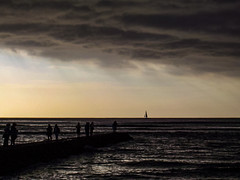 Get Home Before the Storm (Steve Taylor (Photography)) Tags: sail jetty wharf pier brown monocolor monocolour monotone people silhouette cloud stormy sky hawaii yacht boat