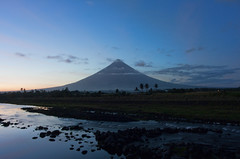 Mayon Volcano (FullofTravel) Tags: volcano mayon philippines luzon bicol legazpi sunset travel asia sky dark shape cone mountain tropics landscape outdoors scenics river water rock current