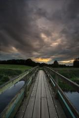 Storm bridge (andyk11) Tags: clouds bridge sunset storm water river sunlight dorset uk andyknowles perspective