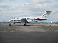 Photo of G-OLIV parked.