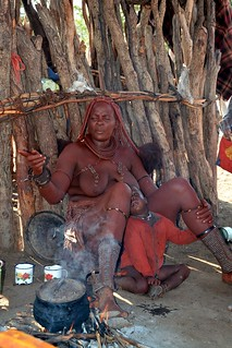 Himba village life - cooking by fire - a Himba village in Kaokoland, Namibia.
