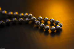 Into the gold (traptiantiwary) Tags: beads goldenlight closeup infocus stilllife canon