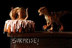 Surprise! (Studio d'Xavier) Tags: surprise secondarysurprise barbie dinosaur cake pink stilllife strobist toys
