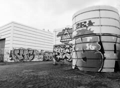 Several Layers of Graffiti (holtelars) Tags: pentax 645 pentax645 645n 6x45 smcpentaxfa 45mm f28 120 film 120film rollei rolleirpx rolleirpx100 100iso mediumformat analog analogue blackandwhite classicblackwhite bw monochrome filmforever ishootfilm filmphotography xtol jobo autolab atl1500 homeprocessing larsholte urbex ht graffiti depot terminal garage kokkedal denmark danmark