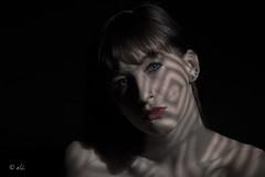 Dark side of light (Catching_alchemic light) Tags: shadows stobe studio lighting technique gobos cast eyes lips shadow contrast catchlight portrait