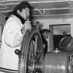 Inuit pilot of the Eastern Arctic Patrol ship MV Regina Polaris, with Samuel D. Ford... / Pilote inuit du navire à moteur Regina Polaris de la patrouille de l'est de l'Arctique... En arrière-plan : Samuel D. Ford thumbnail