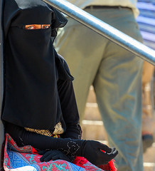 Will you still need me? Will you still feed me, when I'm 32? (ybiberman) Tags: israel jerusalem oldcity alquds muslimquarter woman hijab niqab beggar blueeyes sad candid streetphotography portrait people ramadan