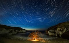 Beacon to the stars (Justin Cameron) Tags: flamboroughhead astrophotography stars samyang14mmf28 canon5dmkiii dusk longexposure sparks coastline night wirewool wideangle startrails starscape polaris flamborough coast northlanding stacking