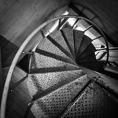 Downward Spiral (tim.perdue) Tags: instagramapp square squareformat iphoneography uploaded:by=instagram downward spiral metal industrial steel staircase leveque tower columbus ohio urban exploration urbex old iphone instagram mobile black white bw monochrome architecture basement