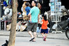 Got his hands full (Roving I) Tags: fathers dads family children boys girls street walking shops hoian hats postcars carrying instep vietnam