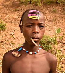 Bush Toothbrush, Mursi Tribe (Rod Waddington) Tags: africa african afrique afrika äthiopien ethiopia ethiopian ethnic etiopia ethnicity ethiopie etiopian omo omovalley outdoor mursi mago tribe traditional tribal culture cultural boy toothbrush bush beads hairclips