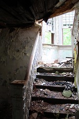 Stairs to the now-collapsed second floor. (seventh_sense) Tags: abandoned ruins decay house deserted home homestead porch overgrown field overgrowth brambles weathered derelict decayed decaying rotting fire damage damaged destroyed burned charred collapse collapsed collapsing victorian garrison owings mills maryland firedamaged