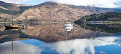 Ballachulish Bay Reflections (PeterYoung1.) Tags: atmospheric beautiful ballachulish landscape boats nature reflections pano panorama scenic scotland scottish scene seascape peteryoung1 uk water