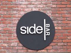 Side Bar circular sign (Pest15) Tags: sanfrancisco sidebar circle sign signage outdoorsign bar clementstreet streetphotography brickwall