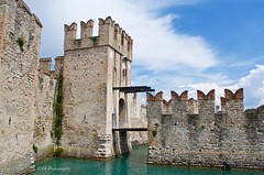 Drawbridge Hospitality, Scaliger Castle, Sirmione, Italy (GSB Photography) Tags: italy lombardy castle fortification drawbridge lakegarda sirmione scaligercastle village town harbor lakeside clouds nikon d60 100v10f 250v10f 500v20f 1000v40f aplusphoto 1500v60f
