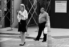 Quick Sip (burnt dirt) Tags: houston texas downtown city town mainstreet street sidewalk corner crosswalk streetphotography fujifilm xt1 bw blackandwhite girl woman people person phone cellphone purse bag standing walking man couple pair blonde ponytail headphones heels stilettos drink straw