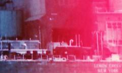 (daveknapik) Tags: detail screenshot lomochromepurple film 35mm abstract longislandcity nyc ravenswoodgeneratingstation lightleaks canonet canonetgiiiql17