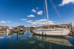 Atmosphere of the haven (hjuengst) Tags: rügen lauterbach haven harbour port sailboat clouds reflection balticsea