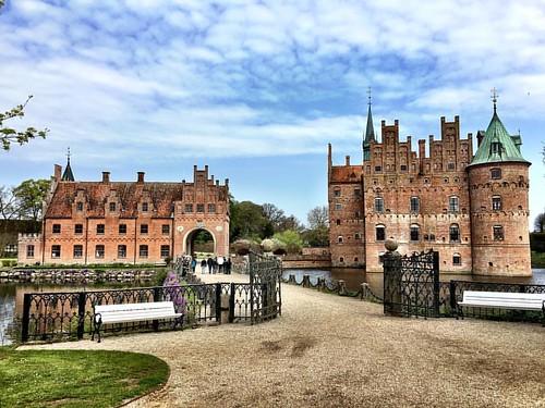 Romantic renaissance Egeskov Castle in Denmark. #egeskov #egeskovslot #egeskovcastle #fyn #funen #denmark #visitdenmark #visitfyn #castle #moat #renaissance #slot #cloudy #dänemark #danmark #scandinavia #travel