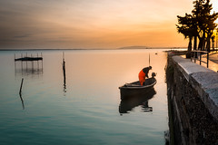 Pescatore (SDB79) Tags: lago lesina pesca pescatore barca molo alba natura