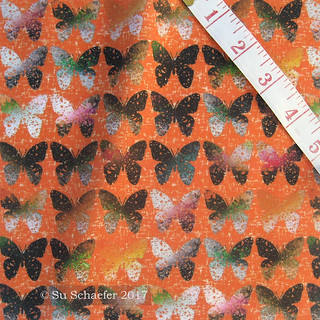 'Dark and stark butterflies on hot wind-whipped orange by Su_G' on basic cotton