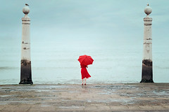 Self portrait 13/52 (Teresa_R_) Tags: selfportrait lisbon lisboa symmetry terreiro do paço symmetrical girl red umbrella fantasy conceptual moody imagination water river
