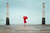 Self portrait 13/52 (Teresa Risco) Tags: selfportrait lisbon lisboa symmetry terreiro do paço symmetrical girl red umbrella fantasy conceptual moody imagination water river