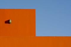 Lamp on a orange wall (Jan van der Wolf) Tags: map16860v wall muur light lamp shadow sky luchtt blue geometric geometry minimalism minimalisme grancanaria arinaga