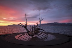 A Sun Voyager Sunset (joshuay04) Tags: iceland sunvoyager sunset reykjavik water harbor sky sun orange golden goldenhour mountains landscape snowcapped distance river blue viking ship history europe atlantic peaceful traveling adventure fuji xpro2 xf1655mmf28
