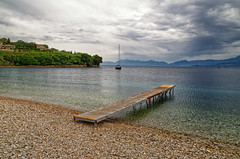 Sailing In (Alfred Grupstra) Tags: nature landscape sea lake water sky summer scenics outdoors blue tranquilscene coastline mountain beach nopeople island travel beautyinnature vacations cloudsky kassiopi corfu