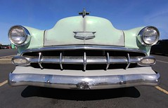 Age of Chrome (RZ68) Tags: 1954 chevrolet chevy car bel air 2 door hot rod classic vintage chrome lime green mint old patina perfect flawed beautiful curves lg g6 wide angle camera phone camerphone android bright sunlight high key grill headlights hood ornament jet plane sky