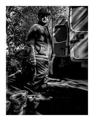 camouflaged (seba0815) Tags: ricohgrdiv grdiv grd monochrome bw people camouflages fleamarket contrast light shadow man hat blackwhite blackandwhite black white schwarzweis czarnobiale outdoor sun sunlight streetphotography bianco nero blanc noir seba0815 ricoh