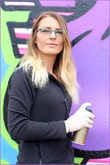Portraits from the street - Laura (Finding Chris) Tags: madeiradrive brighton graffiti artist graffitiartist hoardings spraypaint smile chrisbarbaraarps canon60d
