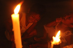Kids behind light (Bruce Estilo) Tags: candles night evening warm philippines journalism lowlight canon line perspective