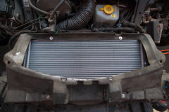 ZF2Y6492.jpg (Adam the ribless) Tags: repair racecar removal vx220 elise lotus ly36 sun clam fiberglass british vauxhall sportscar servicing radiator performance racing