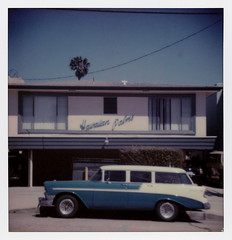 Hawaiian Palms (tobysx70) Tags: the impossible project tip polaroid sx70sonar sonar instant color film for sx70 type cameras tele15 lens impossaroid hawaiian palms beachwood drive canyon hollywood hills los angeles la california ca apartment building palm tree blue sky 1956 chevrolet chevy belair stationwagon wagon classic car automobile surfwag pink turquoise toby hancock photography