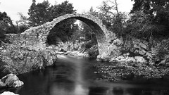 as our past keeps crumbling away ... (lunaryuna) Tags: uk scotland cairngorms carrbridge historicpackhorsebridge damaged historicarchitecture bridge architecture beauty landscape river stone blackwhite bw monochrome lunaryuna