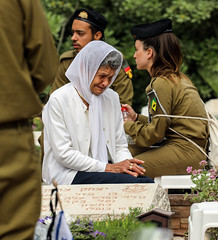 God Full Of Mercy (ybiberman) Tags: israel jerusalem mountherzl thememorialdayforthefallensoldiersofisrael woman soldiers mourning grave crying portrait candid streetphotography people veil idf