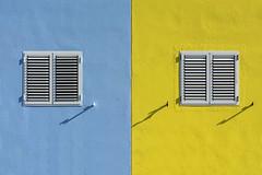 Two windows in a blue and yellow wall (Jan van der Wolf) Tags: map167303v windows ramen facade gevel blue blauw shadows schaduw shadowplay symmetric symmetry dissymmetry grancanaria crucedearinaga house huis geel
