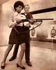 Saundra Brown, 28, the first black woman on the Oakland police force, gets instructions on how to shoot a shotgun, 1970. (Radio Man Mike) Tags: oaklandpolice oaklandpd opd police oakland