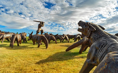 The Wolf Attack (Stuck in Customs) Tags: arrowtown hasselblad newzealand queenstown trey ratcliff stuckincustoms stuckincustomscom treyratcliff rr dailyphoto horizontal colour color march 2017 p2017 x1d art sculpture thehills golfcourse maxpatte movie bridge pond sunset man reflection water sky cloud green grass blue white tussock trees willow mountain rock stone glare sun orange yellow brown fawn grey black dusk red metal standing otago southisland michaelhill outdoor serene