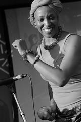 Percussive Beat (peterkelly) Tags: digital bw panasonic lumix zs50 music womenexpression concert festival 2016 kultrunfestival kitchener victoriapark ontario canada northamerica musician dancing woman smiling smile backup betsaydamachado singer necklace bracelet