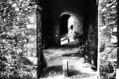 short moment (www.streetphotography-berlin.com) Tags: montefegatesi tuscany italy small village architecture man alone light shadow silhouette street streetphotography streetlife blackandwhite blackwhite impressionism impressionist
