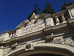 Highland Hospital, Oakland, CA. (melystu) Tags: stucco decorative gate entrance marquee door oakland name highlandhospital railing ballustrade h clay