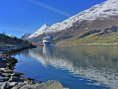 Britannia in Olden (jiffyhelper) Tags: apple iphone se norway cruise britannia ship spring reflection fjord shore rocks snow