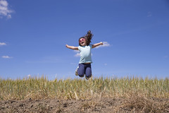 Little girl jumping (Enrique Ramos López) Tags: girl child kid childhood jump field jumping playing person smile vacation outdoors nature pretty little small positive sunny attractive people beauty smiling summer blue sky horizon happiness young joy weekend childish motion active landscape scenery outside emotion happy one fun
