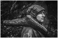 Alan Carrying Wood, Arisaig (Gordon_Farquhar) Tags: alan mitchell arisaig morar beasdale mallaig woods forest carrying wood highlands scotland scottish west coast lochaber side view profile portrait dark black white sad angry foreboding father dad log tree