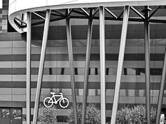 bicycle parking 1 (heinzkren) Tags: fassade front bicycle pillars architecture architektur cyclerack säulen urban fahrrad symbol zeichen icon schwarzweis blackandwhite biancoetnero noiretblanc monochrome schatten shadow scs shoppingcity einkaufszentrum parkplatz parking piktogramm pictogram vösendorf niederösterreich loweraustria ricoh konstruktion construction sw bw linien lines sign facade