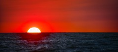 Red Sky at Night, Sailors' Delight (C. P. Ewing) Tags: landscape landscapes sky sun sunset sundown red blue nature natural ocean gulf water seascape colorful beautiful reflection reflected yellow